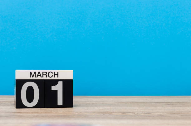 march 1st. day 1 of march month, calendar on light blue background. spring time, empty space for text, mockup - welcome march stock photos and pictures