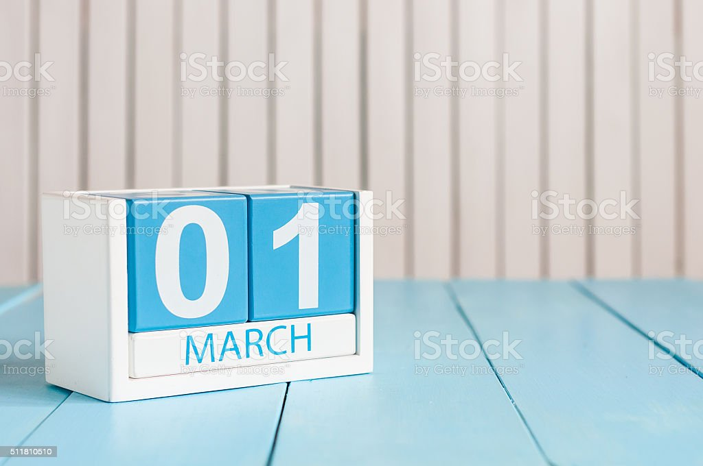 March 1st. Image of march 1 wooden color calendar on stock photo