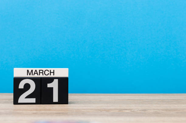 march 21st. day 21 of month, calendar on table with blue background. spring time, empty space for text - number 21 stock photos and pictures