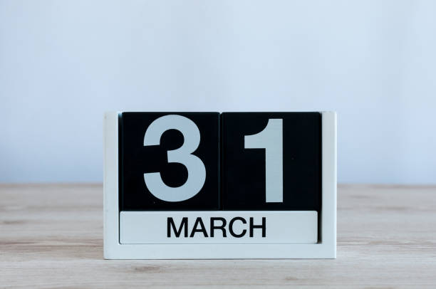 March 31st. Day 31 of month, everyday calendar on wooden table background. Spring time, empty space for text stock photo