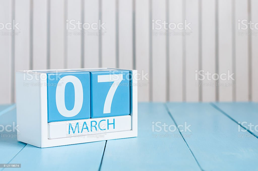 March 7th. Image of march 7 wooden color calendar on stock photo