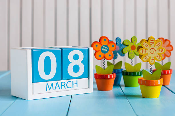march 8th, save the date blue block calendar for international - womens day stock photos and pictures