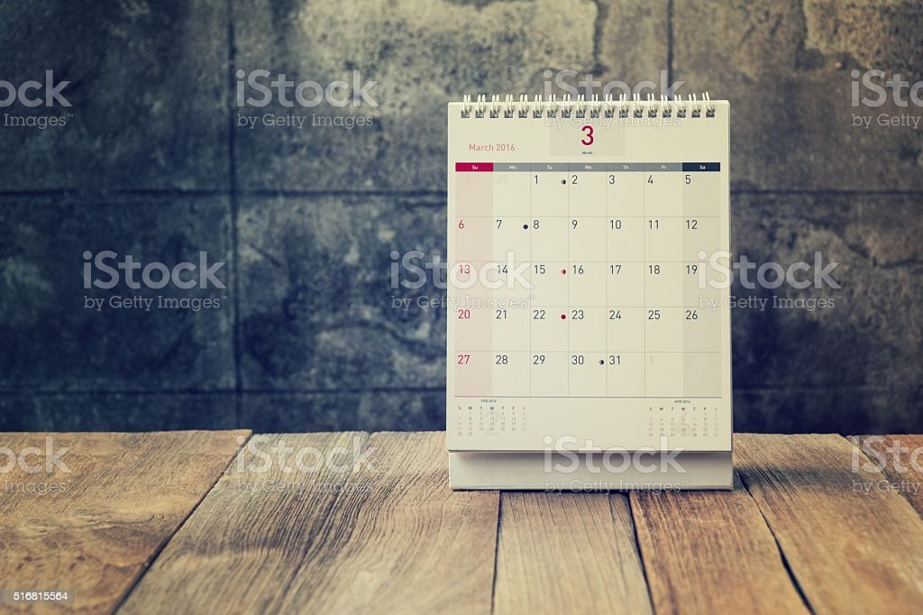 March Calendar 2016 on wood table,vintage filter stock photo