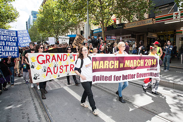 march in march political protest melbourne - f1 melbourne bildbanksfoton och bilder