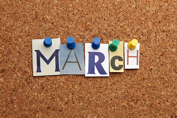 March pinned on noticeboard stock photo
