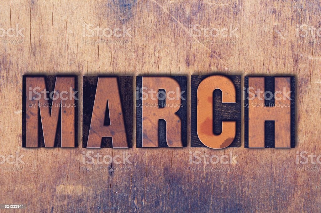 March Theme Letterpress Word on Wood Background stock photo
