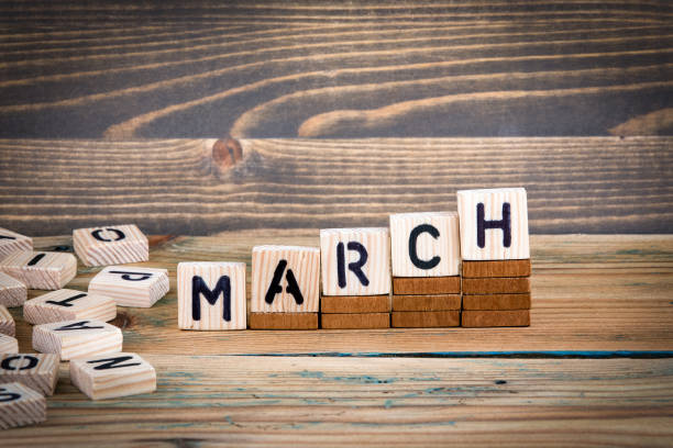 march. wooden letters on the office desk, informative and communication background - marzo foto e immagini stock