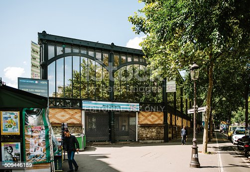 Paris, France - August 18, 2014: Main entrace of the Marche Saint Quentin Market one of the most ancient Paris covered markets seen on Boulevard de Magenta  near Gare du Est. The building was buit around 1800