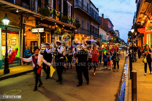 New Orleans, LA/USA  Jan 12, 2019: Marching band and many  people playing music and dancing at French Quarter, New Orleans, Louisiana