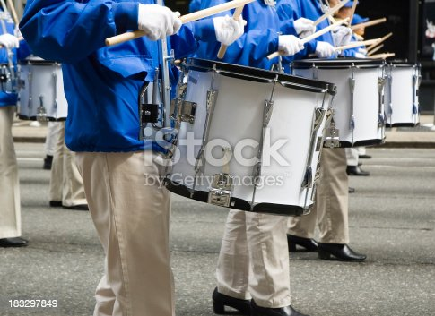 Close-up of a line of marchers playing snare drums in a street parade.Click below to view similar photos and all my music related images:
