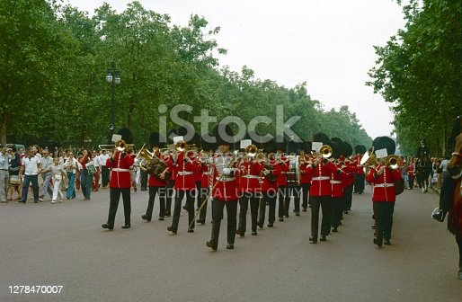 London, England, UK, 1978. Marching Band of the Grenadier Guards on the Mall in London. Furthermore: Locals, tourists and mounted police.