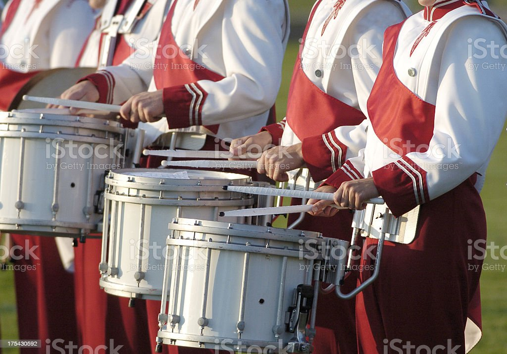 Marching band playing drums with red uniform stock photo
