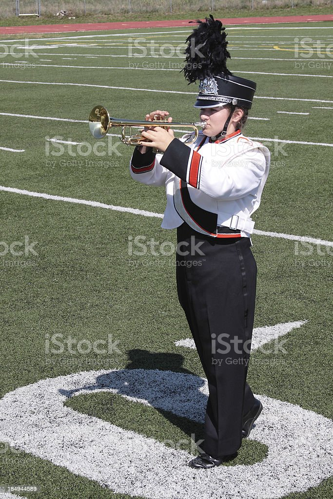 Marching band student playing the trumpet stock photo
