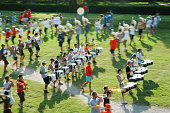 Stillwater, OK, USA - September 28, 2005: Unidentified college students in blurry pan shot on the field during marching band rehearsal