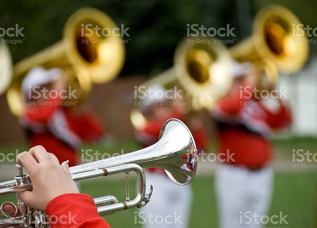Marching band trumpet close-up on field stock photo