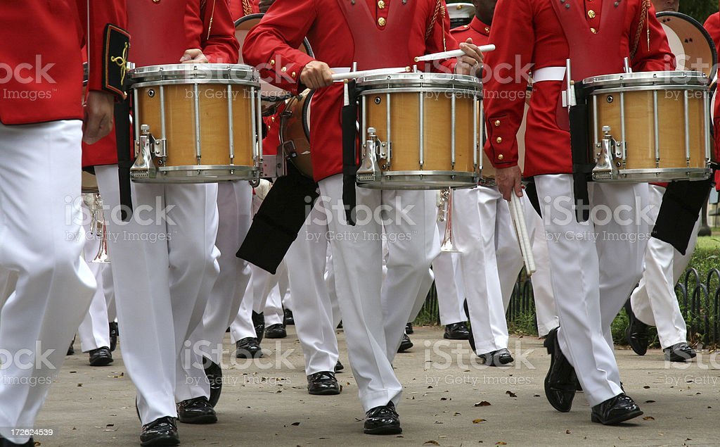 Marching Band With Drummers Walking Down The Street At fair royalty-free stock photo