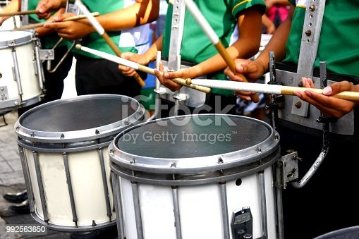 Close up photo of a marching band's drummers playing the drums