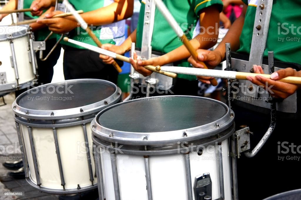 Marching band's drummers playing the drums stock photo