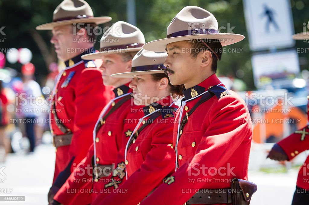 RCMP marching in Canada day parade. stock photo