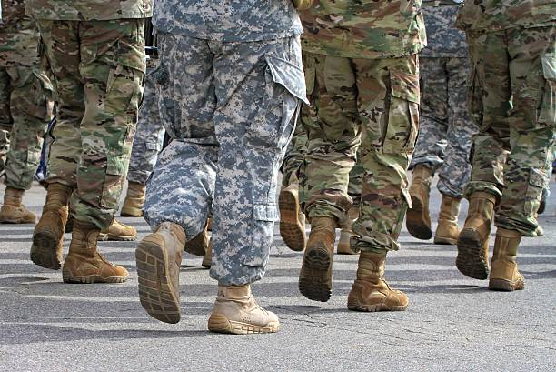 Marching Soldiers marching in a parade. marching stock pictures, royalty-free photos & images