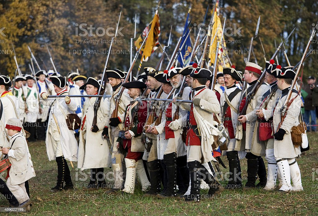 marching soldiers in historic regimentals stock photo