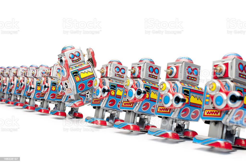 Marching tin toy robots stock photo