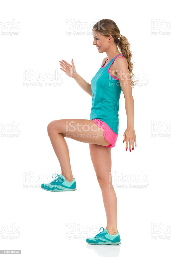 Marching Woman In Sport Clothes stock photo