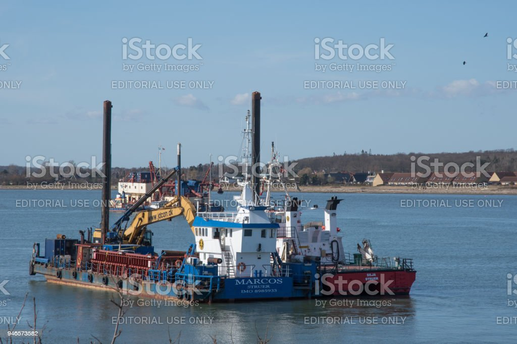 Marcus a multipurpose construction vessel with a hydraulic excavator stock photo