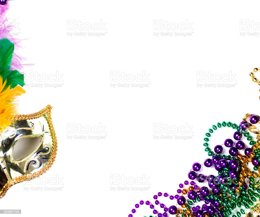 Mardi Gras background.  Purple, gold, green, mask, beads. stock photo