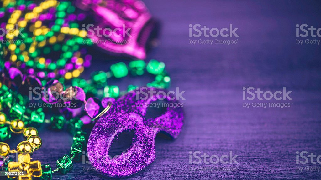 Mardi Gras background with assorted novelty bead necklaces stock photo