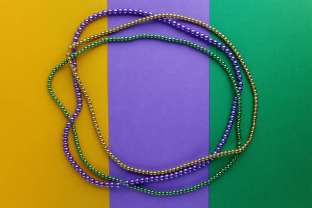 mardi gras beads background with place for text. top view - mardi gras borders silhouette stock photos and pictures
