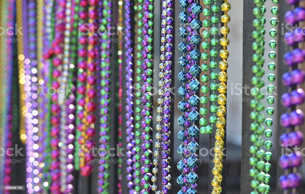 Mardi Gras beads in a row royalty-free stock photo