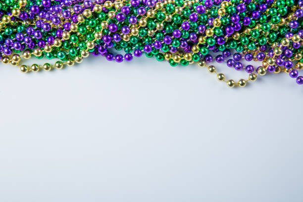 Mardi gras carnival background - beads and mask stock photo