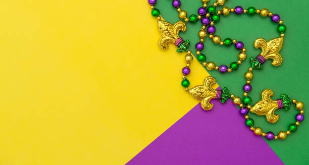 Mardi gras carnival decoration beads yellow green purple background Mardi gras carnival decoration beads on yellow green purple background mardi gras stock pictures, royalty-free photos & images