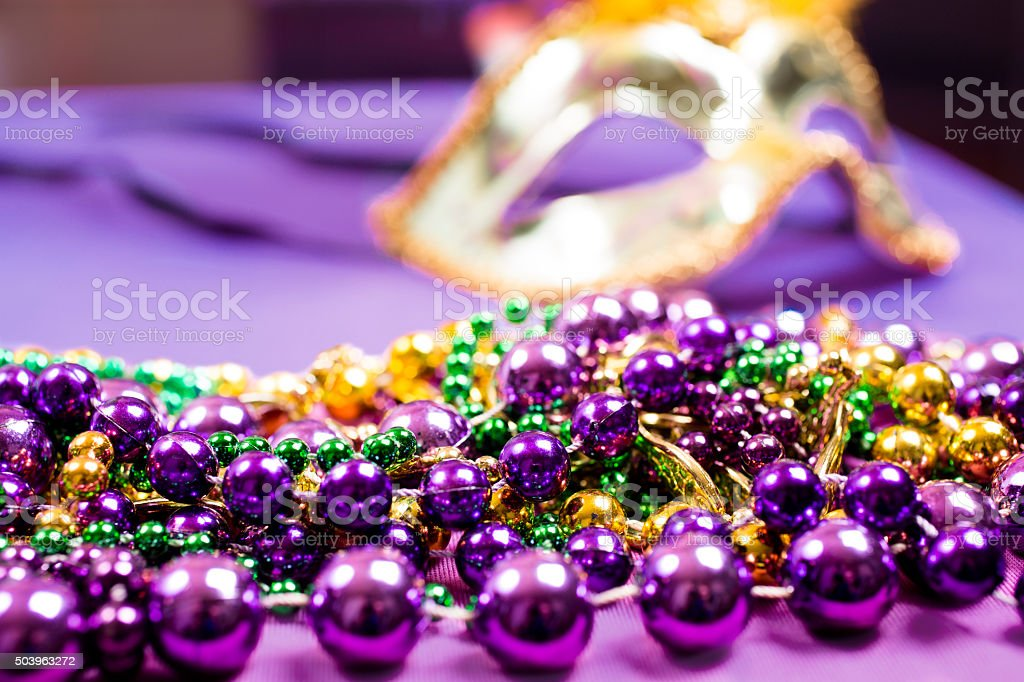 Mardi Gras, Carnival.  Purple, gold, green, mask, beads. stock photo
