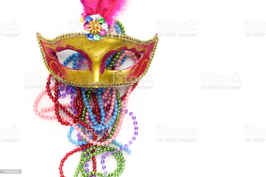 Mardi gras mask and beads on white background.Top view. stock photo