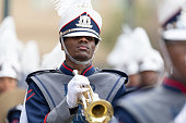 New Orleans, Louisiana, USA - February 23, 2019: Mardi Gras Parade, Members of the Kipp Renaissance High School, Marching Bobcats, performing at the parade