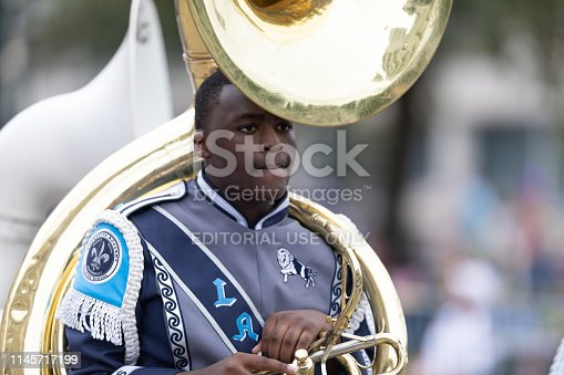 New Orleans, Louisiana, USA - February 23, 2019: Mardi Gras Parade, The Lafayette Academy Marching Lions Band, performing at the parade.