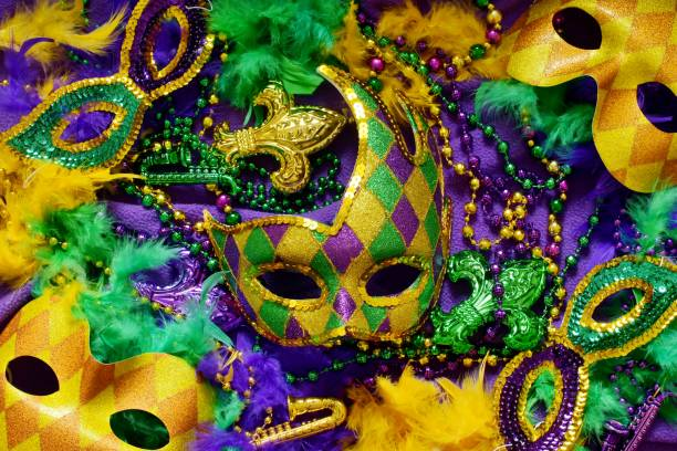Mardi Gras Colorful masks and decorations on a purple background mardi gras stock pictures, royalty-free photos & images