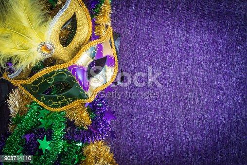 Mardi Gras, venetian carnival mask on a purple background