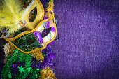 Mardi Gras, venetian carnival mask on a purple background