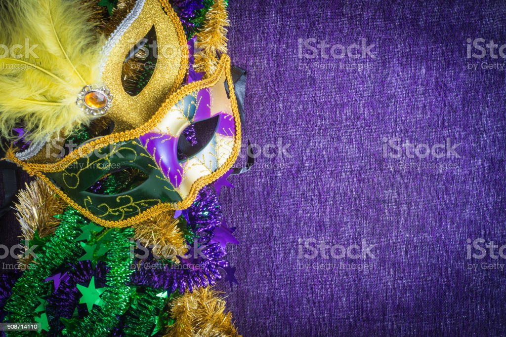 Mardi Gras, venetian carnival mask on a purple background stock photo