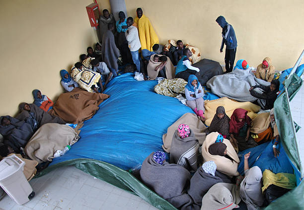 mare nostrum - triton rescue operation - human trafficking stock photos and pictures
