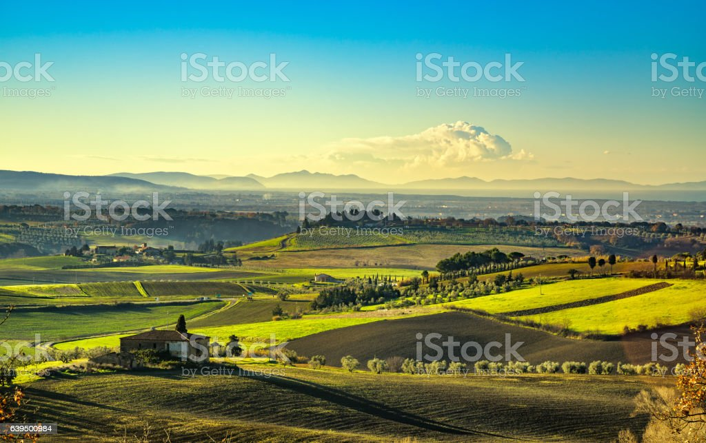 Maremma, rural sunrise landscape. Countryside old farm and green stock photo