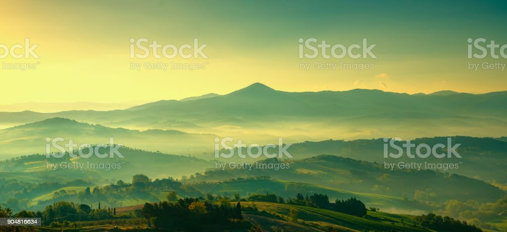 Maremma, rural sunset landscape. Countryside old farm and green field. Tuscany, Italy. stock photo