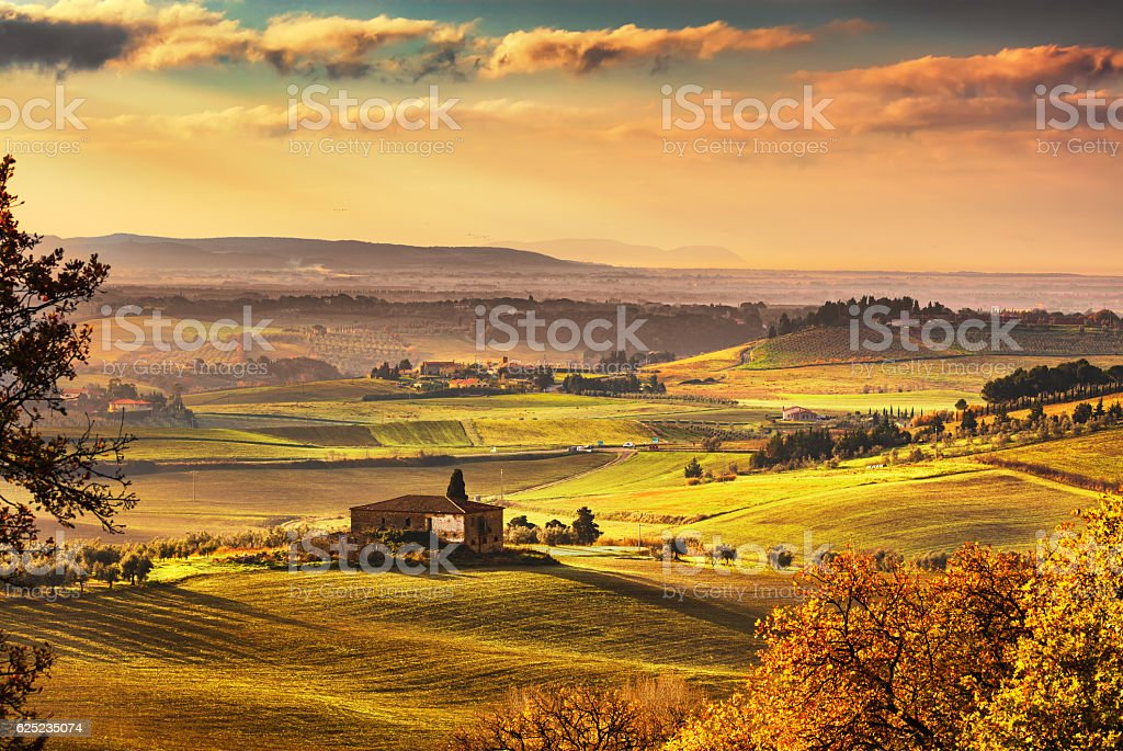 Maremma, rural sunset landscape. Countryside old farm and green stock photo