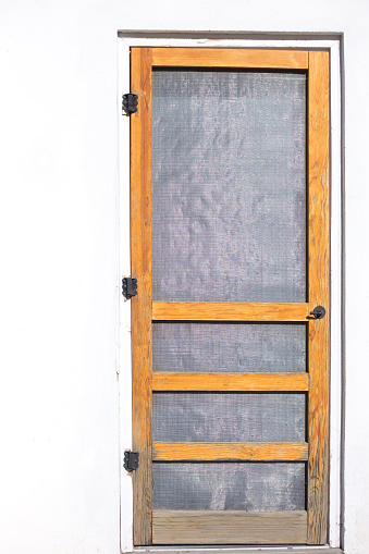 Marfa TX Style: Rustic Screen Door, Whitewashed Adobe Wall