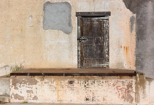 Marfa TX Style: Sunlit Old Door, Pale Weathered Orange Wall