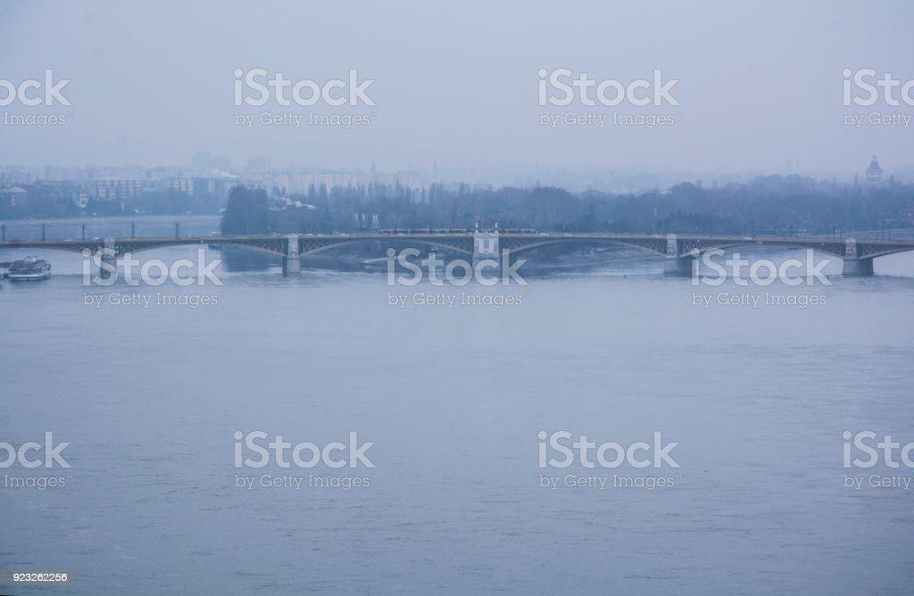 Margaret Bridge and Margaret Island in the mist. stock photo