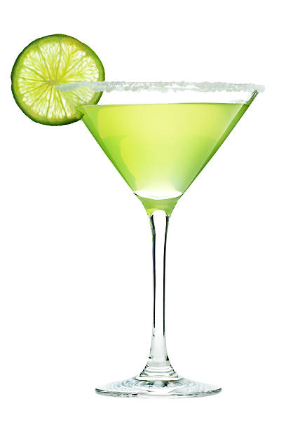 Margarita Cocktail Drink in Martini Glass with Salt and Lime Subject: A cold Margarita cocktail isolated on a white background. margarita stock pictures, royalty-free photos & images
